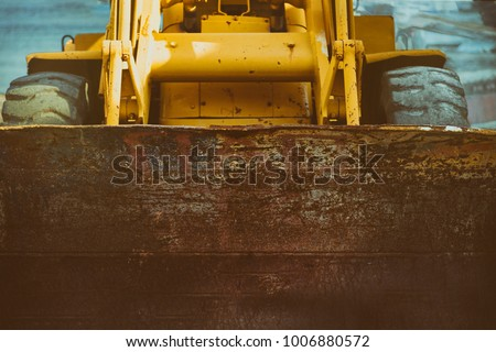 Yellow Excavator.  Close-up front view.