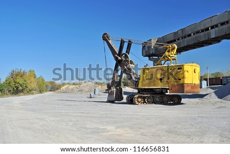 yellow excavator in the quarry
