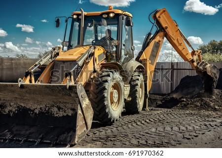Yellow excavator operation, close-up