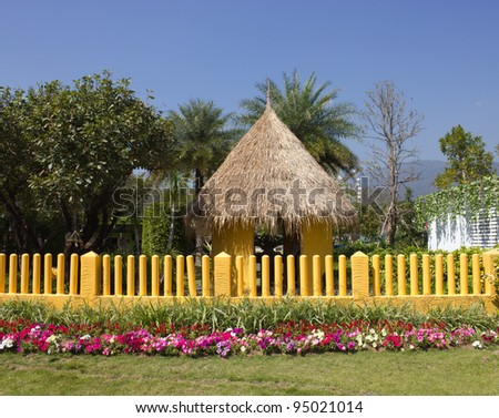 Yellow fence and flower garden