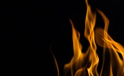 Yellow fire flames, isolated on black background,