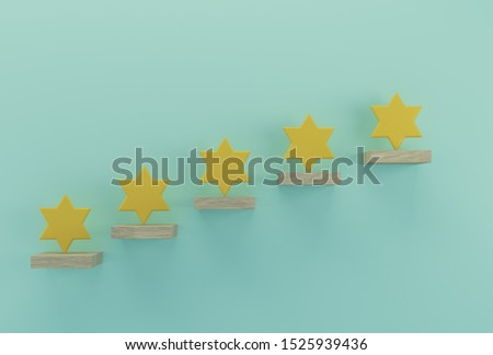 Yellow five star shape on wooden sticks. The best excellent business services rating customer experience concept Stock fotó ©