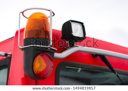 yellow flashing light on special equipment or a gift car and red and white headlights #1494819857