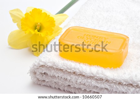 yellow flower and soap on the towel