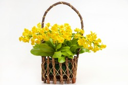 yellow flower bouquet from artificial flowers arrangement centerpiece in basket isolated on white background