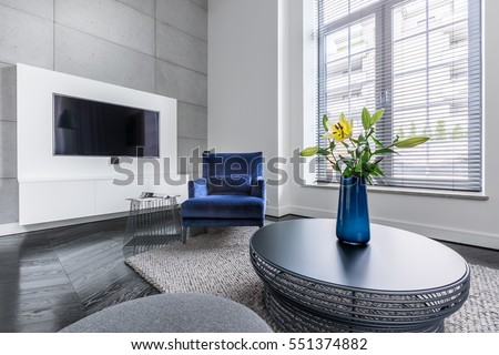 Yellow flowers in vase on decorative coffee table #551374882