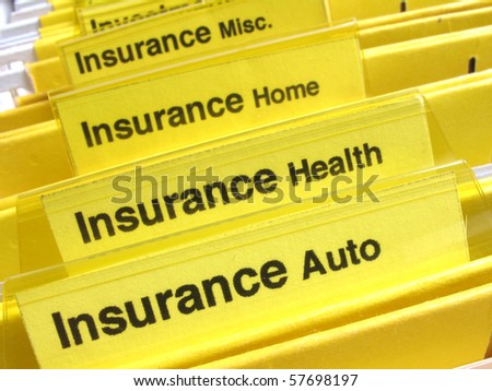 Yellow folders show different types of insurance papers
