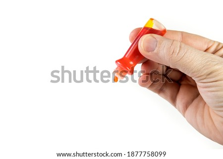 Yellow food coloring bottle being squeezed at an anglr isolated over white Foto stock ©