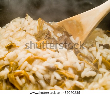 Yellow Foot Mushroom Risotto Steaming in a Kettle with a Spoon