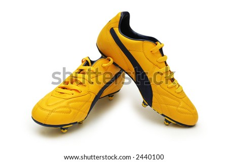 Yellow football boots isolated on the white - stock photo