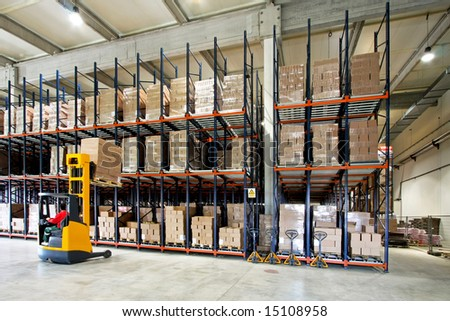 Yellow fork lifter work in big warehouse
