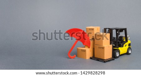 Yellow Forklift truck near carton boxes with a pattern of shopping carts and umbrella. insurance, providing warranty on purchased products. Protection manufacturer. Economic crisis. Banner, copy space #1429828298