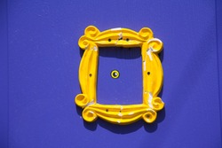 Yellow frame or peephole on blue door
