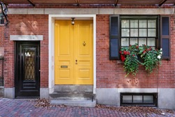 Yellow front door to classic style home
