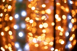 yellow garland lights bokeh illumination abstract Christmas wallpaper concept photography
