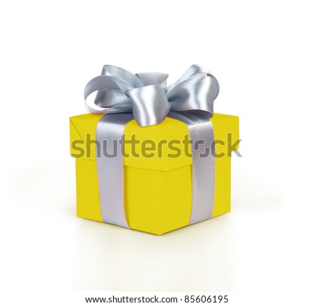 yellow gift box with silver ribbon and bow isolated on white
