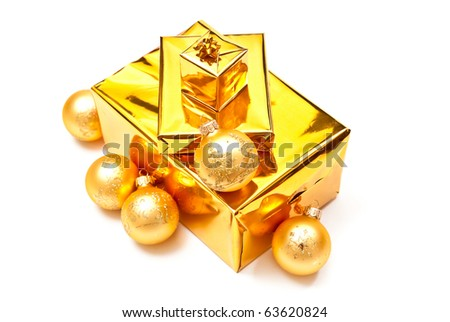 Yellow gifts boxes with christmas balls. Isolated on white #63620824