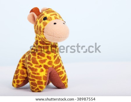 yellow giraffe over white background. Animal toy