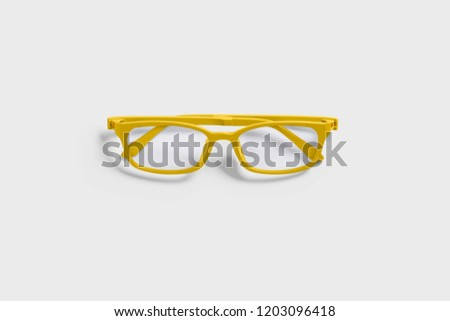 Yellow glasses isolated on soft gray background.