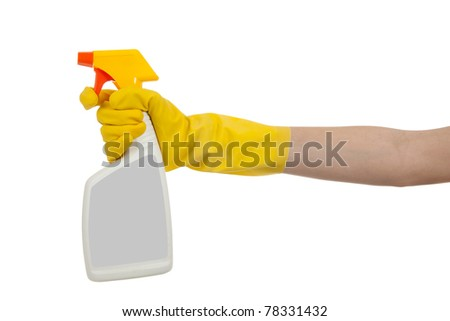 Yellow gloved hand with white and yellow spray bottle with copy space