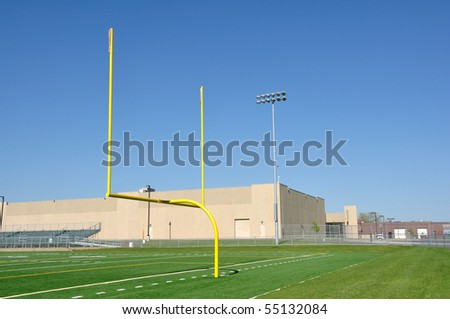 Yellow Goal Posts on American Football Field