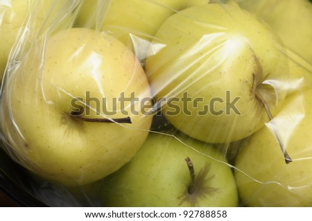 Yellow Golden Apples packed in plastic film, sold in bulk