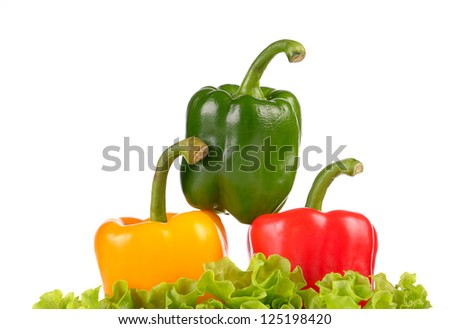 Yellow Green and Red peppers on salad leaf  isolated on white background