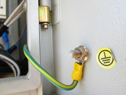 Yellow-green ground cable in a metal box The gray breaker box has a ground cable built in to protect against electric shock and has a yellow sticker with a ground symbol on the lid.