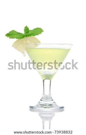 Yellow green martini Mojito Cocktail drink with light rum, lime, spring of mint, club soda and syrup in cocktails martinis glass isolated on a white background