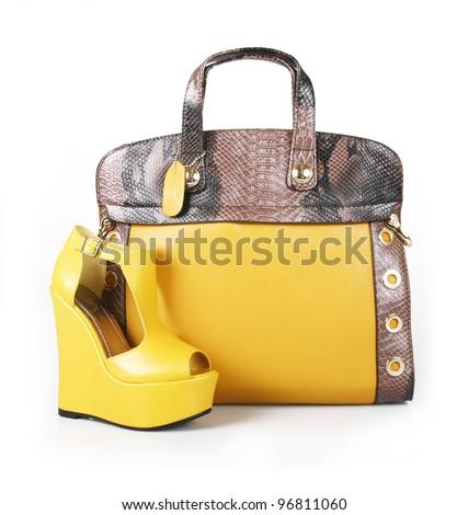 yellow handbag and wedge shoe isolated on white