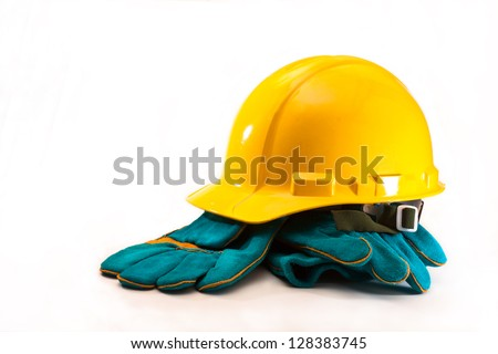 Yellow hard hat and blue gloves on a white background