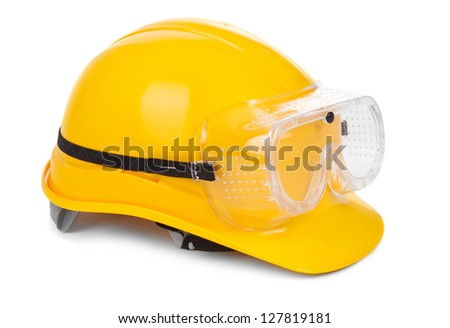 yellow hard hat and goggles on white, small natural shadow under object