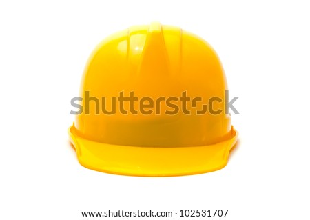 Yellow hard hat, protective equipment in construction industry.