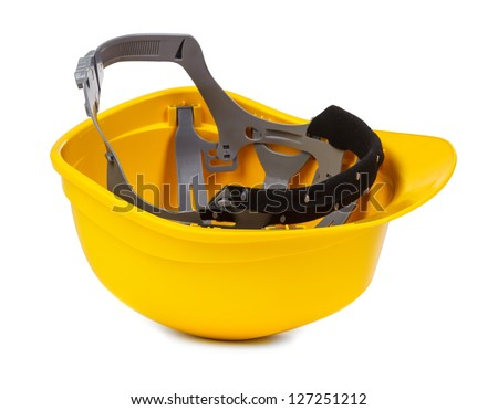yellow hard hat upside down, small natural shadowo under object