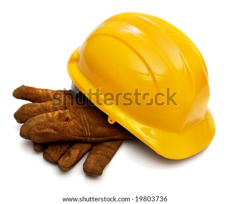 Yellow hardhat and old leather gloves isolated on white background