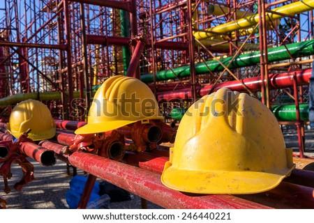 yellow hardhat on construction site