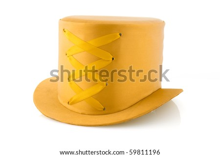 Yellow hat with ribbon isolated on white background.