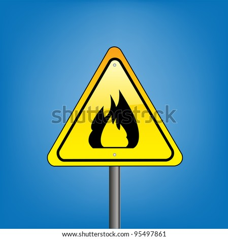 Yellow hazard warning sign on against blue sky - open flame warning