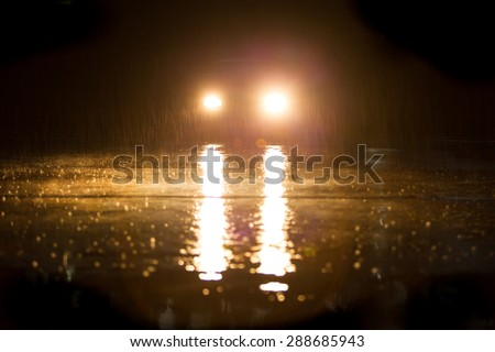Yellow headlight and road in the dark while heavy raining. #288685943
