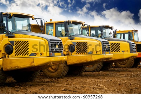 Yellow heavy construction tipper trucks