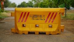 yellow heavy duty plastic barrier, equipment barricading on roadside
