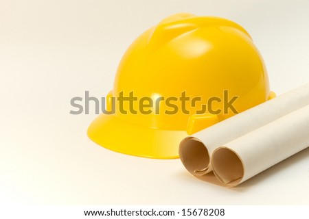 yellow helmet and paper roll isolated over white