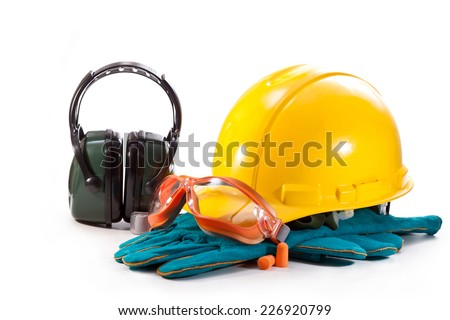 Yellow helmet, gloves and goggles with headphones on white background