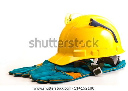 Yellow helmet safety goggles and gloves on a white background
