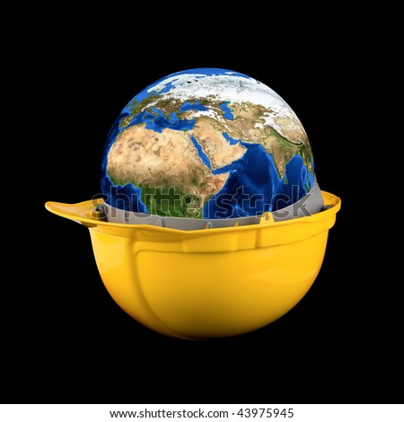 Yellow helmet with earth planet isolated on a black background