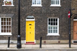 Yellow house door on a London street