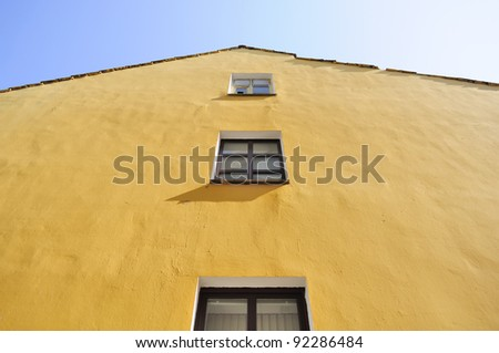 Yellow House Facade with Windows