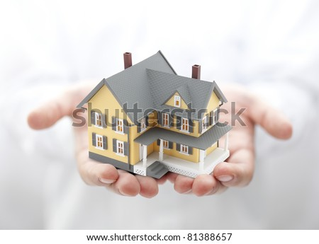 Yellow house in hands