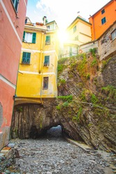 Yellow house on tunnel rock in Vernazza, traditional italian village in cinque terre, Liguria - Italy
