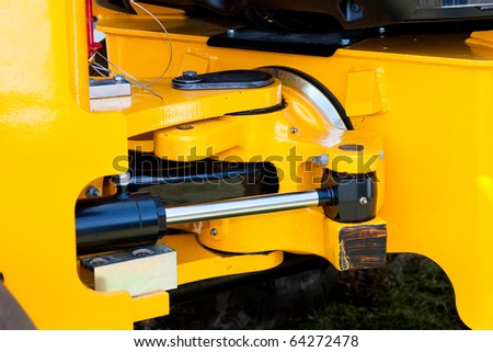 Yellow Hydraulic Excavator Articulation Mechanism Close Up Detail